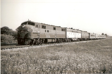 The Prairie State crossed a lot of Illinois prairie during its journey between Chicago and St. Louis. The train is shown southbound on May 28, 1972, between Joliet and Dwight. On the point is GM&O E7A No. 103A.