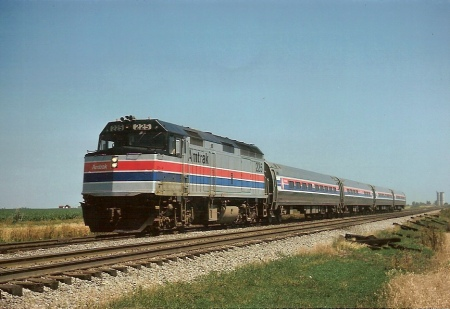 The Shawnee was the second Amtrak train in the Midwest to be assigned Superliner equipment. It is shown south of Champaign with its standard late 1970s consist of two coaches, a food service car and a F40. (Photograph by James McMullen)