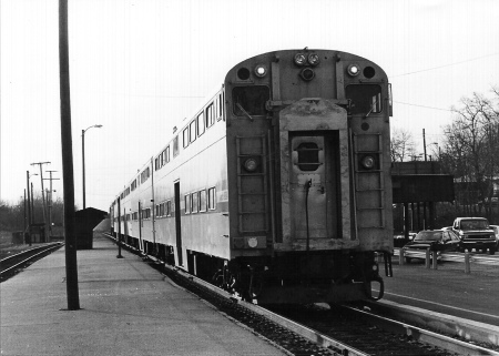 Amtrak contracted with Illinois Central Gulf to rebuild four former Chicago & North Western bi-level coaches into cab cars. Two of them were assigned to Chicago-Valparaiso service in 1981. A cab car is shown on an eastbound train at Indiana Harbor in November 1988. (Photograph by John Clark)