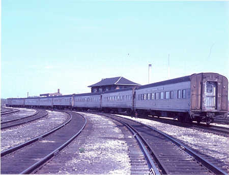 Meet the new train, same as the old train. In Amtrak's early weeks, its trains were mere extensions of what has operated on the route previously. The first eastbound Spirit of St. Louis under Amtrak auspices leaves Indianapolis Union Station on May 1, 1971, with all Penn Central equipment in the consist. (Photograph by John Fuller)