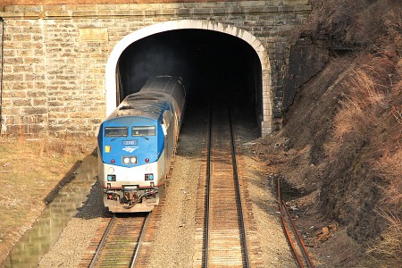 Amtrak's westbound Pennsylvanian emerges from a tunnel in Galitzin, Pa., in April 2013.