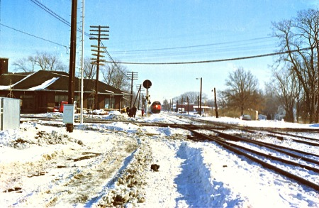 The first photograph of an Amtrak train that I ever made. The westbound National Limited is coming into the station at Effingham, Ill., in January 1977.