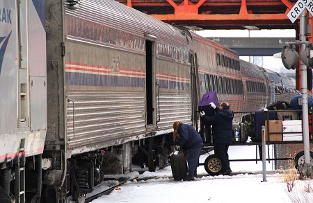 Two Cleveland Amtrak agents load and unload baggage from the Boston baggage car of 448.