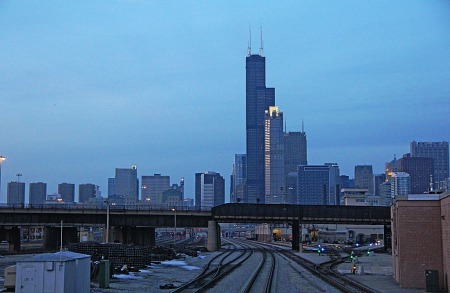 The Willis Tower looms over downtown Chicago as No. 30 continues its outbound journey. The bridge in the foreground carries the St. Charles Air Line, which is used by Amtrak's Illini, Saluki and City of New Orleans.
