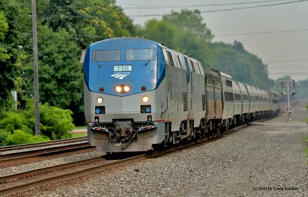 The westbound Lake Shore Limited is more than 10 hours late as it saunters through Olmsted Falls, Ohio, on Sunday, July 20.