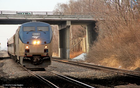 The conductor is looking ahead for passengers as the Saluki approaches the station in Mattoon.