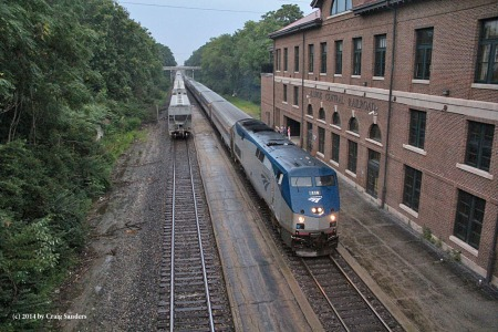 The southbound Illini is about to make its stop at Mattoon, Ill., as a northbound Canadian National freight train clears the station in August 2014.