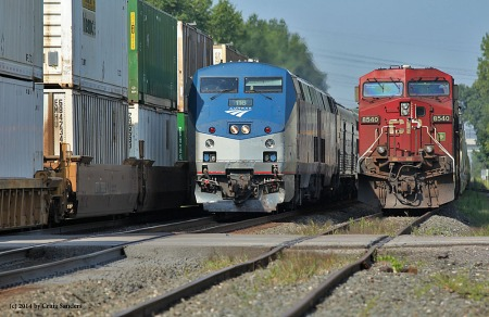 Amtrak's eastbound Lake Shore Limited is sandwiched between an eastbound NS stack train and a parked grain train in Olmsted Falls, Ohio, on Saturday, Aug. 30. Severe congestion on NS caused No. 48 to arrive in Cleveland more than six hours late.