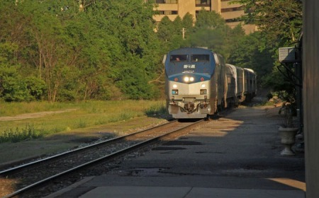 A westbound Wolverine Service train arrives in Ann Arbor in May 2012. The remnants of the platform of the Michigan Central station are visible. The station is out of view to the right.